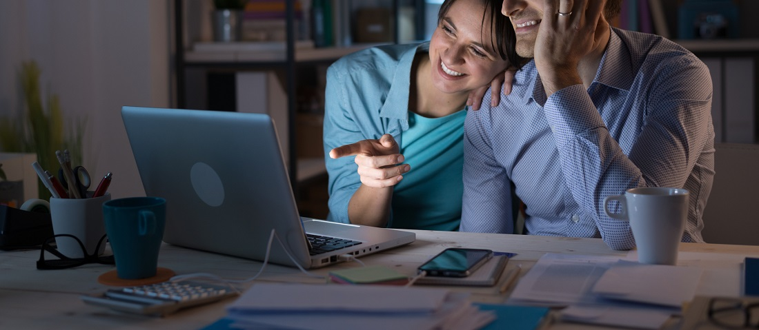 Young couple at home using a computer