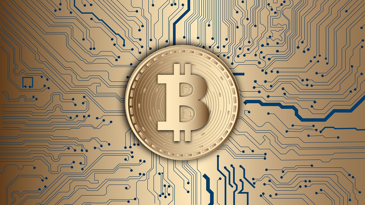 bitcoin on gold circuit background