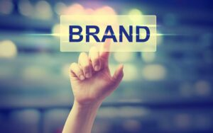 hand pointing at brand