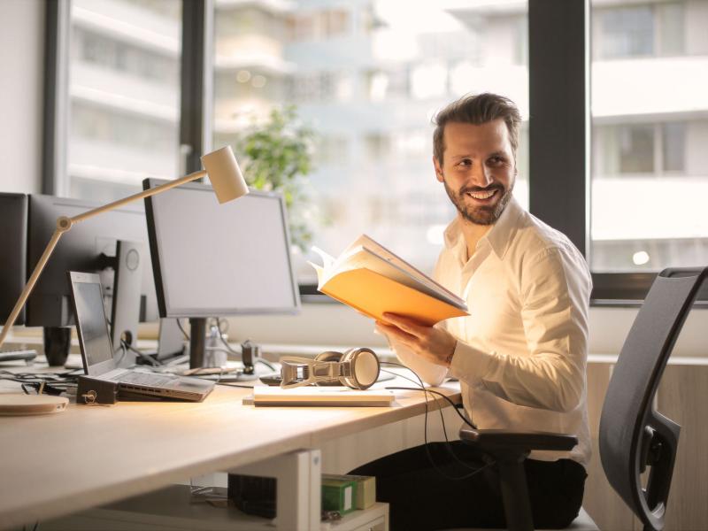 man_smiling_at_work