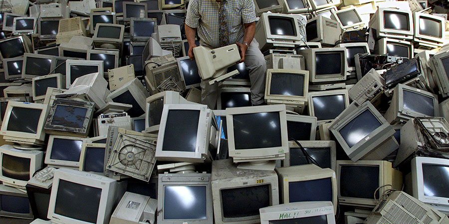 Patrick Maranon lifts a used computer monitor at his Ecomicro recycling company in Bordeaux, June 11..