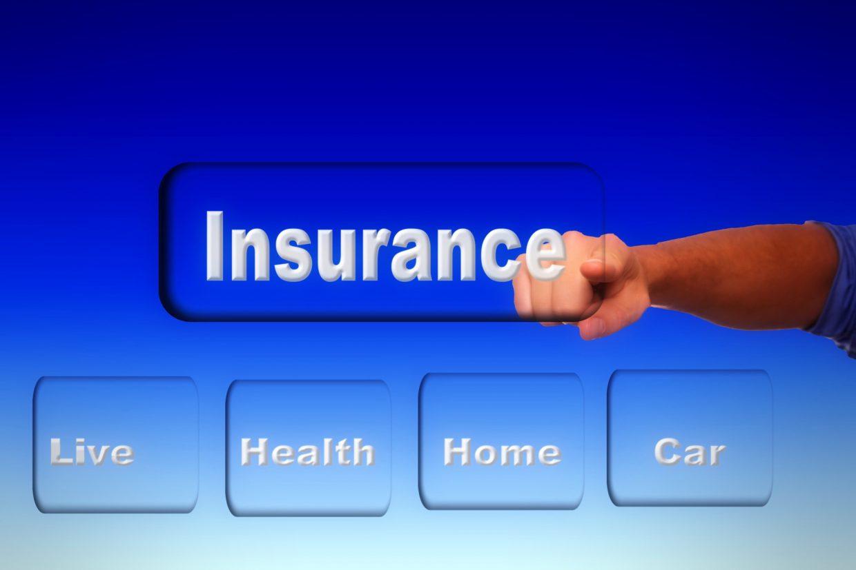 Man pointing at insurance sign