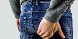 Man in jeans holding backside