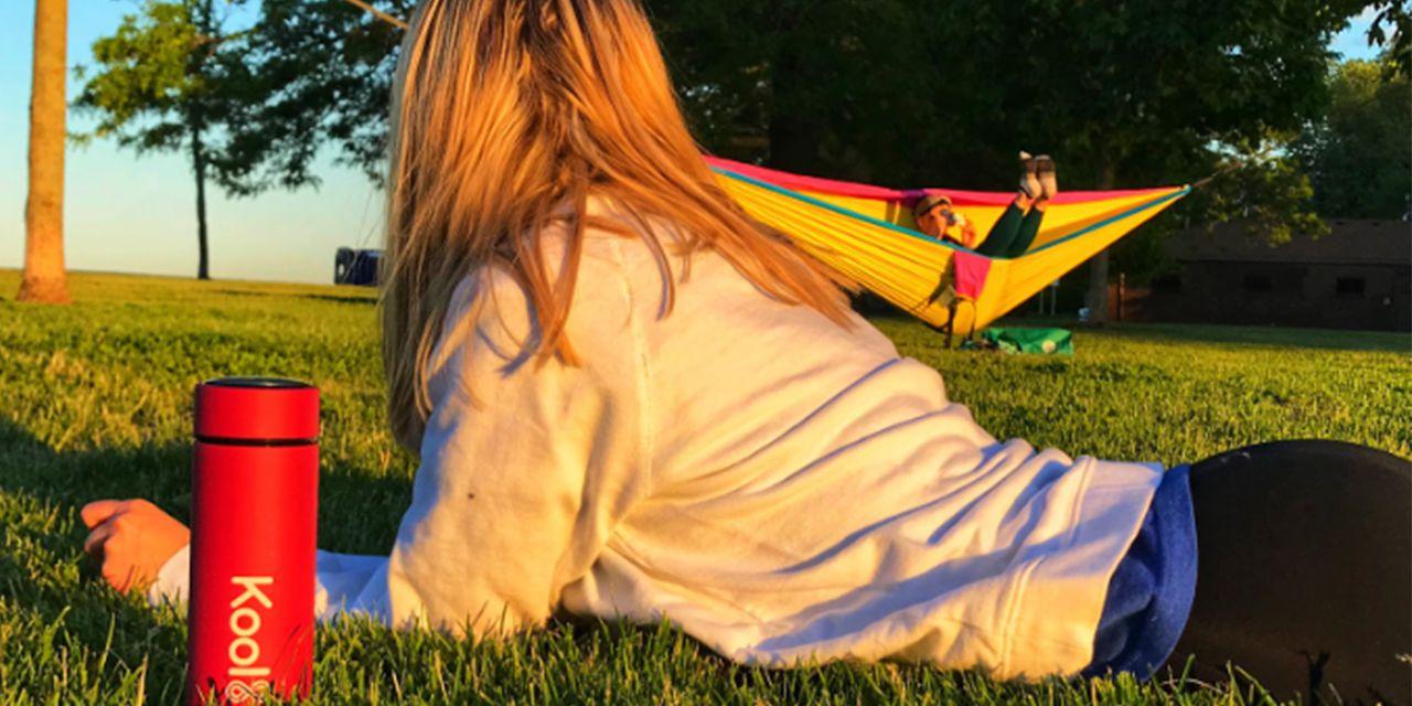 water bottle girl on grass