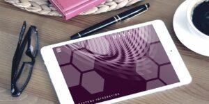 Tablet eyeglasses pen notebook coffee