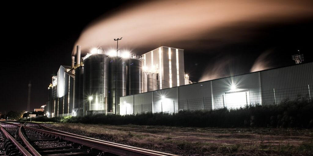 factory night smoke industry plant industrial
