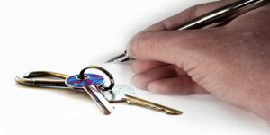 Landlord tenancy agreement key hand lease house keys tenant signaturepen