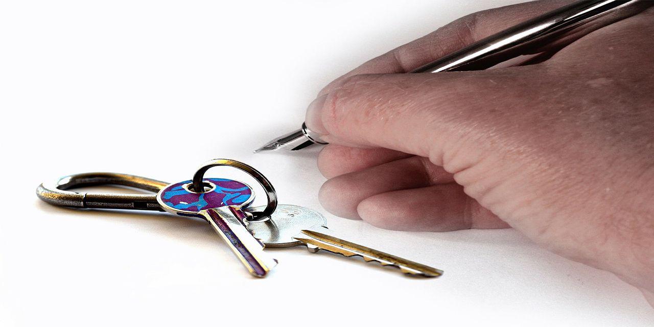 Landlord tenancy agreement key hand lease house keys tenant signaturepen