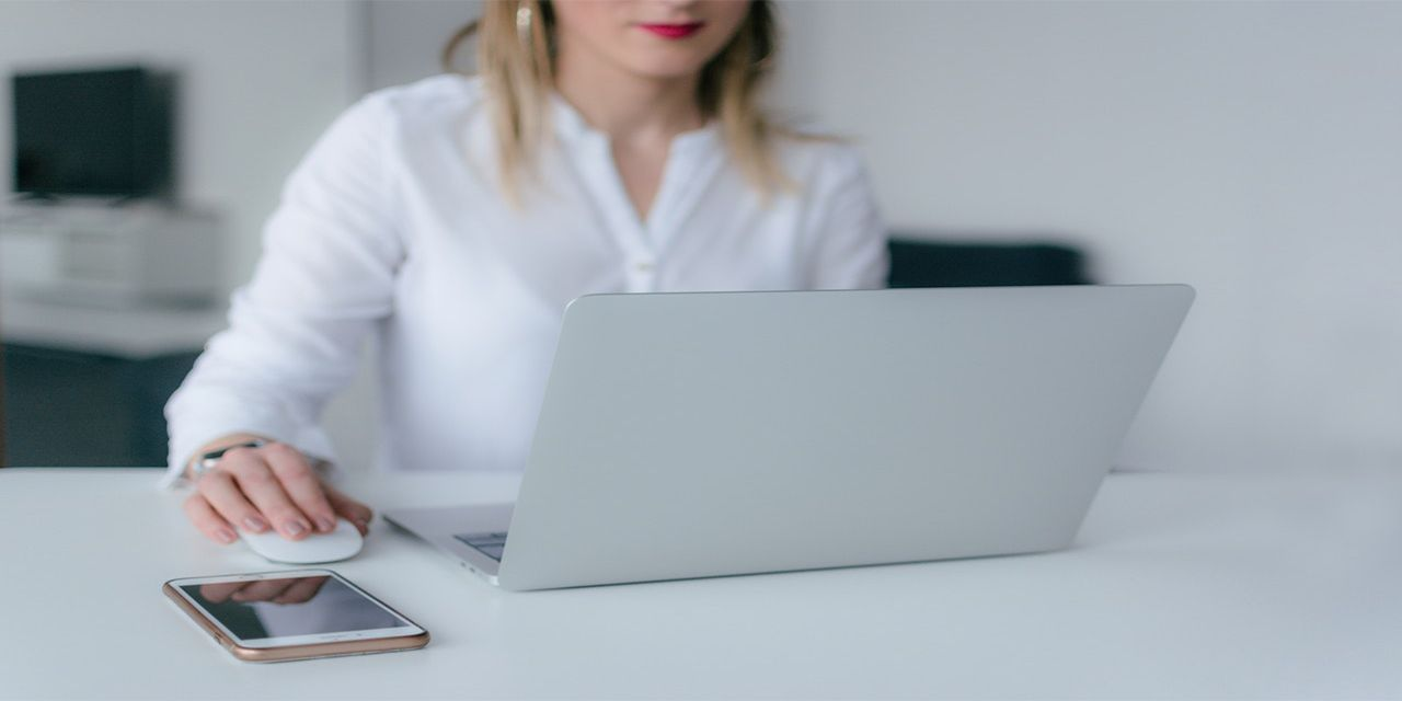business woman using a silver laptop