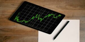 fintech-space-grey-ipad-air-with-graph-on-brown-wooden-table