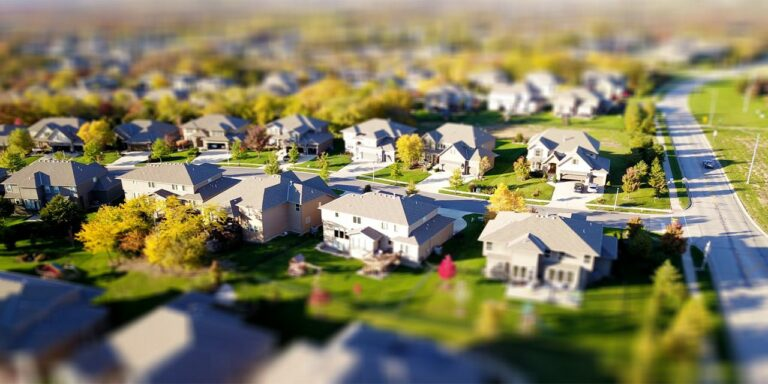 real estate property development high angle shot of suburban neighborhood