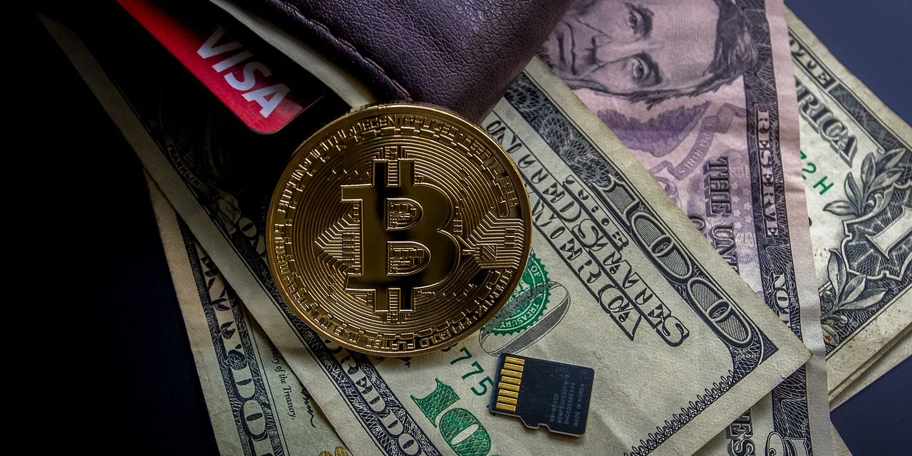 Cryptocurrency next to fiat currency