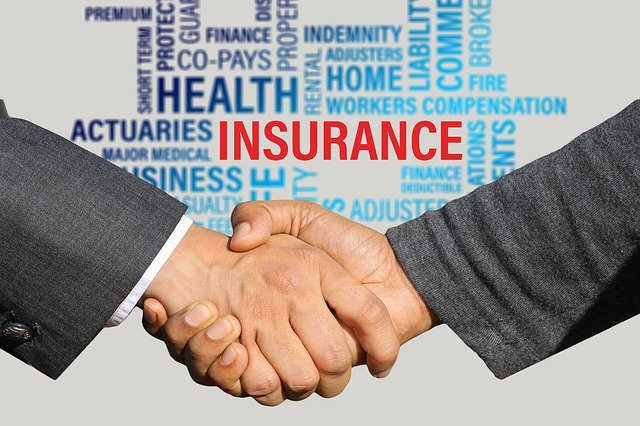 insurance contract shaking hands handshake