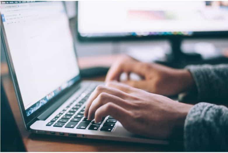 online typing laptop hands
