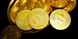 bitcoin toppled over on a gold plate