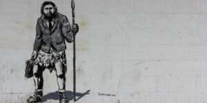 caveman graffiti with suit by crawford jolly