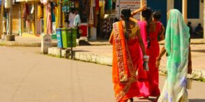 Indian women walking in the supermarket with traditional sarees