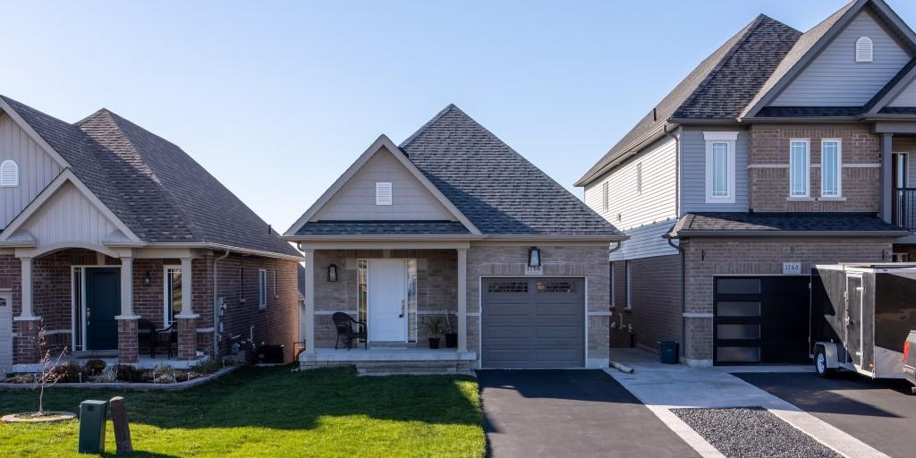 Small grey brick home in a subdivision