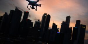 Flying a drone at dusk in the city
