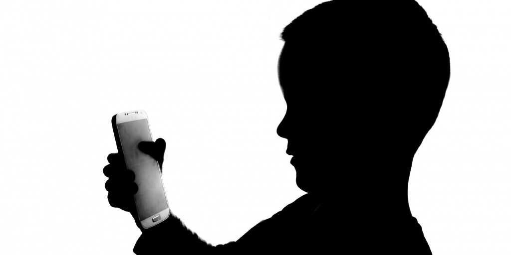 People White Phone Holding Kid Player Side View
