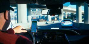 man driving drive driver smartphone dashboard