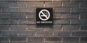 minimal shot of no smoking sign on brick wall